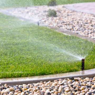 irrigation system watering a lawn